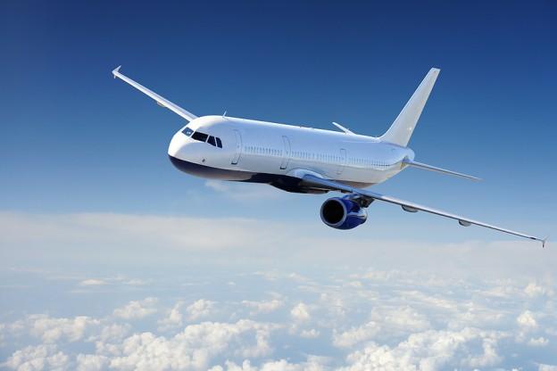 Plane-in-Blue-Sky-624x416